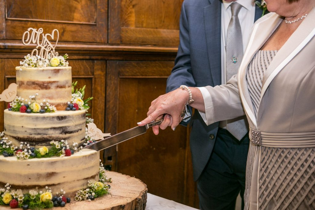 Wedding of Andy & Rose, The Sppech House Coleford, Cutting the Cake, Tania Miller Photography